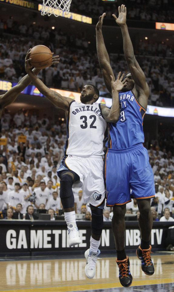 Photo - Memphis Grizzlies guard O.J. Mayo (32) shoots ahead of Oklahoma City Thunder forward Serge Ibaka (9) during the second half of Game 3 of a second-round NBA basketball series on Saturday, May 7, 2011, in Memphis, Tenn. The Grizzlies 101-93 in overtime to take a 2-1 lead in the series. Mayo had 18 points off the bench. (AP Photo/Lance Murphey)