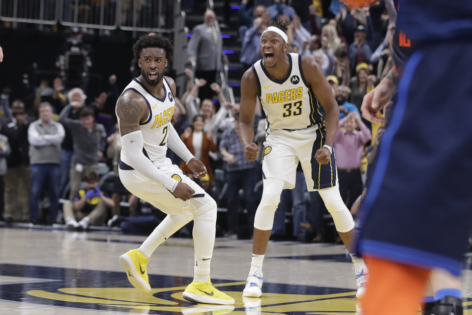 Photo - Indiana Pacers' Wesley Matthews (23) and Myles Turner (33) celebrate during the second half of an NBA basketball game against the Oklahoma City Thunder,Thursday, March 14, 2019, in Indianapolis. Indiana won 108-106. (AP Photo/Darron Cummings)