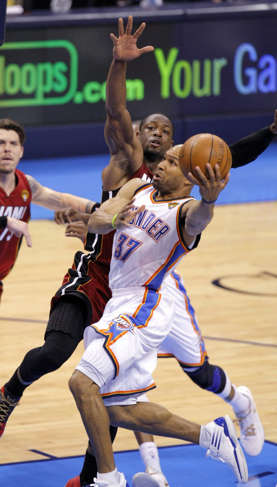 Oklahoma City's Derek Fisher (37) shoots a lay up as Miami's Dwyane Wade (3) defends during Game 1 of the NBA Finals between the Oklahoma City Thunder and the Miami Heat at Chesapeake Energy Arena in Oklahoma City, Tuesday, June 12, 2012. Photo by Sarah Phipps, The Oklahoman