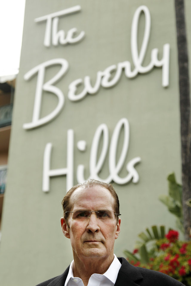 Photo -   In this April 25, 2012 photo, Robert S. Anderson, author and Beverly Hills Hotel historian, poses for a portrait in front of the Beverly Hills Hotel in Beverly Hills, Calif. Anderson's book