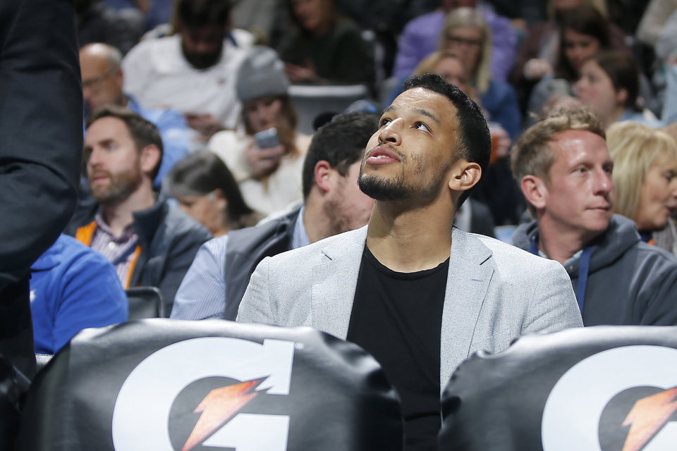 Photo - Oklahoma City's Andre Roberson watches from the bench during an NBA basketball game between the Oklahoma City Thunder and the Memphis Grizzlies at Chesapeake Energy Arena in Oklahoma City, Thursday, Feb. 7, 2019. Photo by Bryan Terry, The Oklahoman