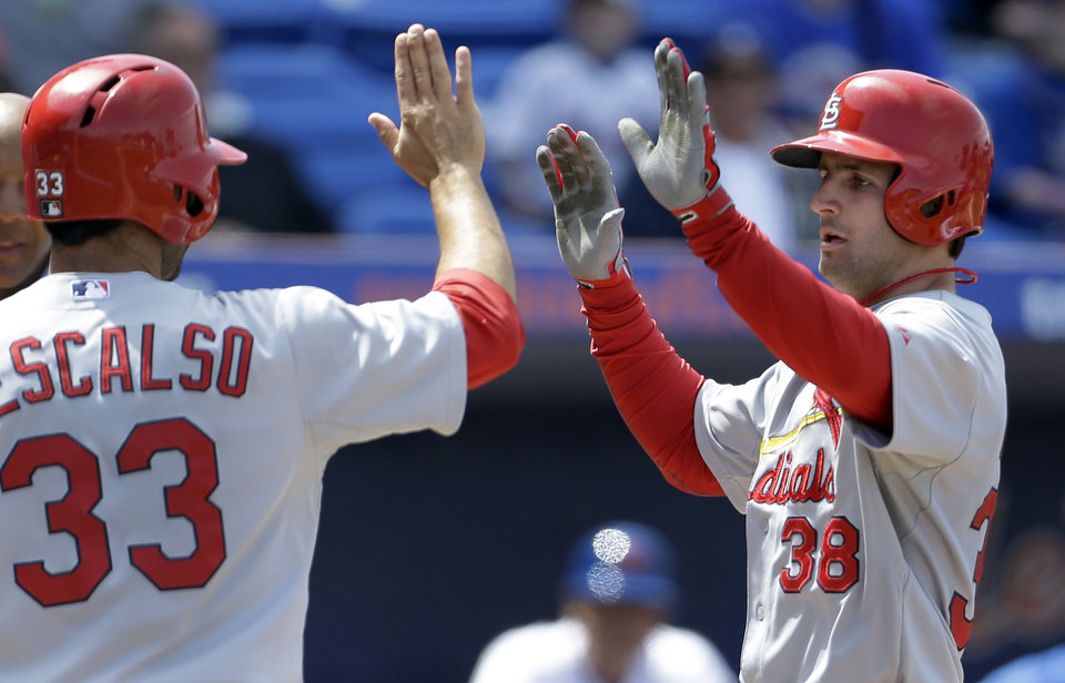 St. Louis Cardinals\' Pete Kozma, right, is congratulated by teammate Daniel Descalso after hitting a grand slam during the fourth inning of a spring training baseball game against the New York Mets Tuesday, March 26, 2013, in Port St. Lucie, Fla. (AP Photo/Jeff Roberson) ORG XMIT: FLVR110