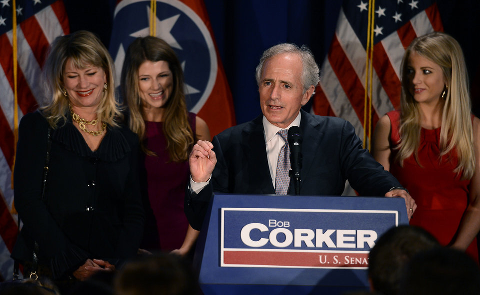 FILE - In this Tuesday, Nov. 6. 2012, photo, Sen. Bob Corker, R-Tenn., is surrounded by, from left, his wife Elizabeth, and daughters Emily and Julia, as he speaks to supporters at an election night victory rally at the Cabana Restaurant on Tuesday, Nov. 6, 2012, in Nashville, Tenn.S enate Republicans would probably agree to increased tax rates on the wealthiest Americans if it meant getting a chance to reform massive government entitlement programs like Medicare and Social Security,Corker  said Sunday, Dec. 9, 2012.  (AP Photo/Mark Zaleski, File)