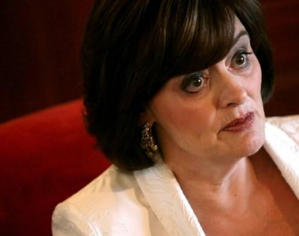 Photo -  Cherie  Blair talks with reporters at the Skirvin Hilton Hotel in Oklahoma City on Tuesday, Sept. 22, 2009. By John Clanton