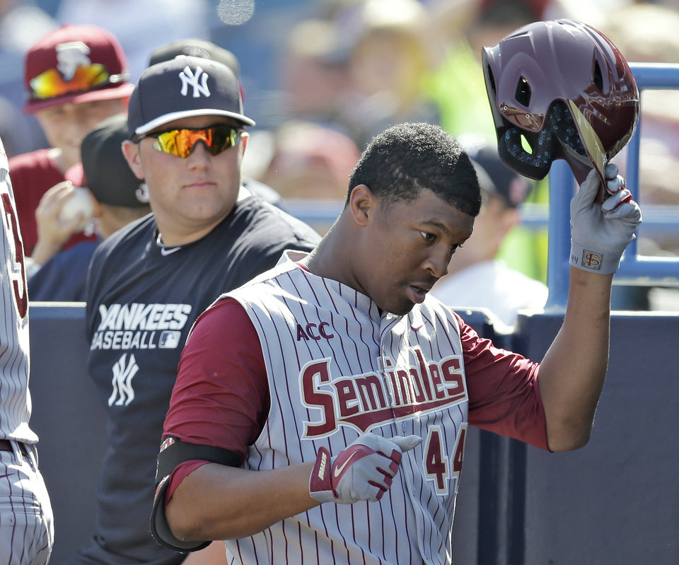 Photo - Florida State's Jameis Winston takes off his helmet after grounding out in the sixth inning during a spring training exhibition game against the New York Yankees Tuesday, Feb. 25, 2014, in Tampa, Fla. Winston is the 2013 Heisman Trophy winner. (AP Photo/Chris O'Meara)