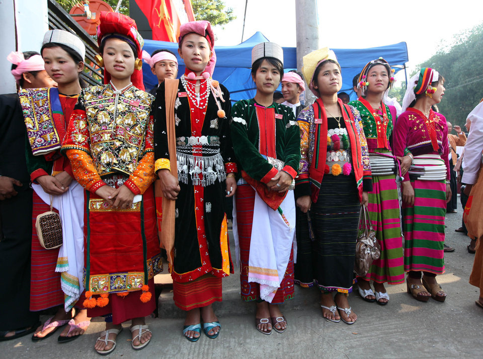 Photo - Clad in traditional dresses, ethnic Palaung members of Myanmar opposition leader Aung San Suu Kyi's National League for Democracy (NLD) party gather outside a venue for their first ever congress of the party at Royal Rose restaurant in Yangon, Myanmar, Saturday, March. 9, 2013. The NLD is holding an all-party congress to elect its own leadership for the first time in the group's 25-year history - an important step toward making it more reflective of its democratic ideals. It is a sign of how far Myanmar has come with political reform that the gathering is allowed at all. But it's also a test for the NLD, which is working to transform itself from a party of one into a structurally viable political opposition in time for national elections in 2015. (AP Photo/Khin Maung Win)