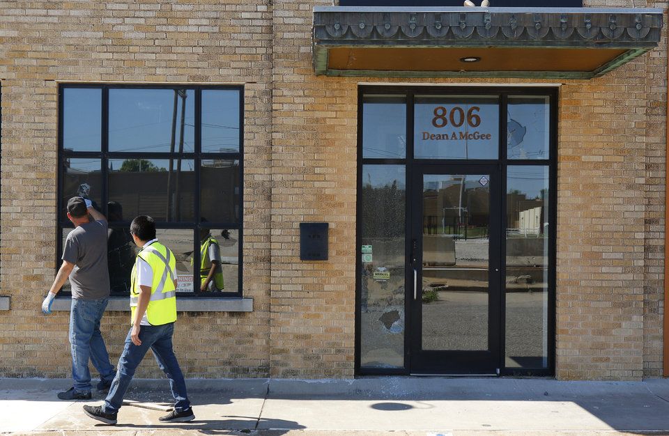 Photo - Surveying the damage at 360 Engineering, on Shartel. Damage from Saturday night protest in downtown Oklahoma City, Sunday, May 31, 2020. [Doug Hoke/The Oklahoman]