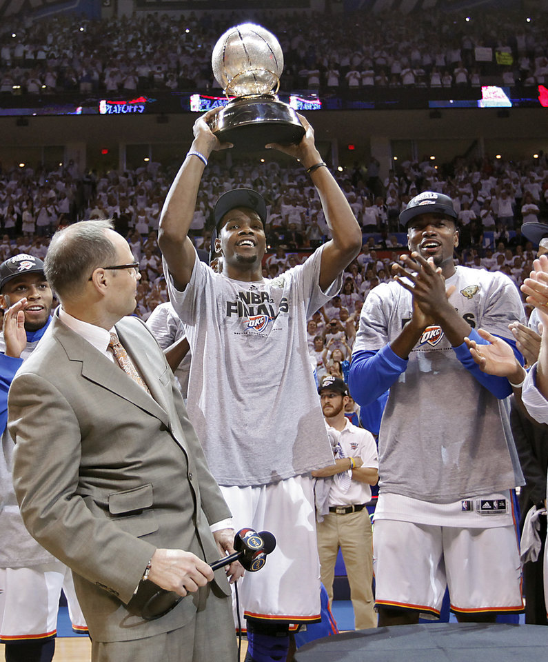 Oklahoma City's Kevin Durant holds the Western Conference Championship Trophy after the 107-99 win over San Antonio during Game 6 of the Western Conference Finals between the Oklahoma City Thunder and the San Antonio Spurs in the NBA playoffs at the Chesapeake Energy Arena in Oklahoma City, Wednesday, June 6, 2012. Photo by Chris Landsberger, The Oklahoman