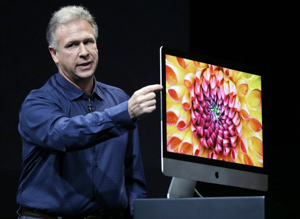 Phil Schiller, Apple�s senior vice president of worldwide product marketing, talks about the thinness of the new iMac on Tuesday in San Jose, Calif. The audience cheered as Schiller unveiled the new iMac computers. Schiller says the fusion drive will have the speed of flash and the capacity of regular hard drives. AP Photo