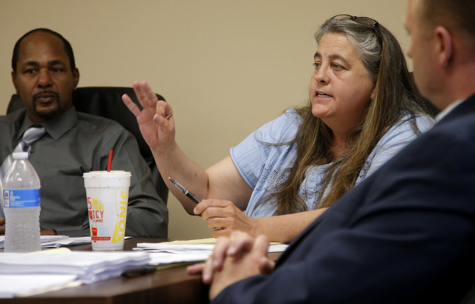 Photo -  Newly appointed Crooked Oak school board member Katie Conway speaks to the crowd during a meeting where citizens expressed their concerns with two school board members' lack of attendance. Photo by Bryan Terry, The Oklahoman   BRYAN TERRY -