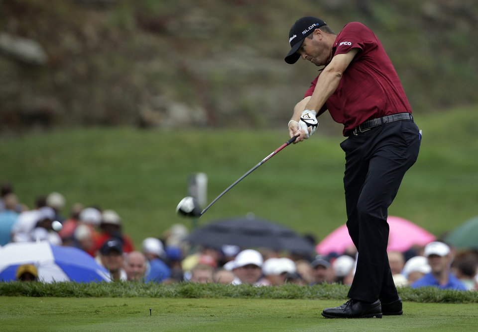 Photo - Ryan Palmer hits his tee shot on the 15th hole during the second round of the PGA Championship golf tournament at Valhalla Golf Club on Friday, Aug. 8, 2014, in Louisville, Ky. (AP Photo/David J. Phillip)