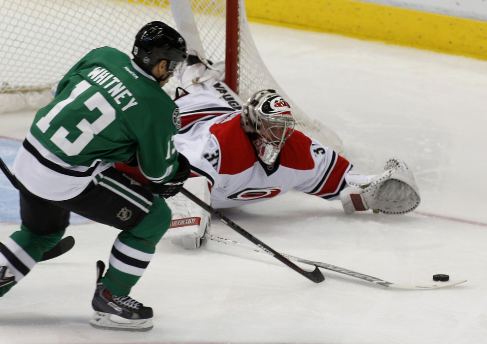 Photo - Dallas Stars left wing Ray Whitney (13) tries to score as Carolina Hurricanes goalie Anton Khudobin (31), of Kazakhstan, makes the save during the second period of an NHL hockey game on Thursday, Feb. 27, 2014, in Dallas. (AP Photo/Sharon Ellman)