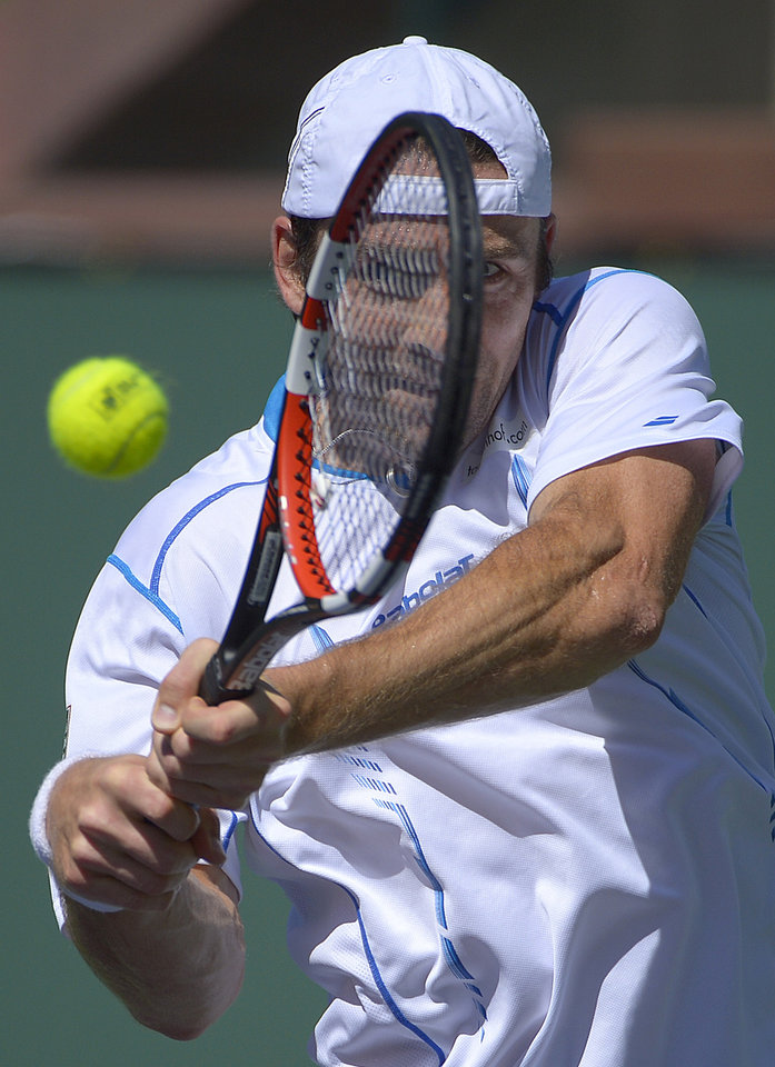 Photo - Benjamin Becker, of Germany, returns a shot against Edouard Roger-Vasselin, of France, during a first round match at the BNP Paribas Open tennis tournament, Thursday, March 6, 2014, in Indian Wells, Calif. (AP Photo/Mark J. Terrill)