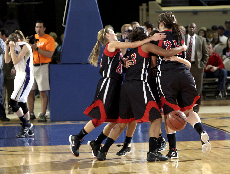 Photo - Frontier celebrates their state championship over Okarche in the Class A girls state championship high school basketball game between  Okarche and Frontier  at the State Fair Arena in Oklahoma City,  Saturday, March 3, 2012. Photo by Sarah Phipps, The Oklahoman