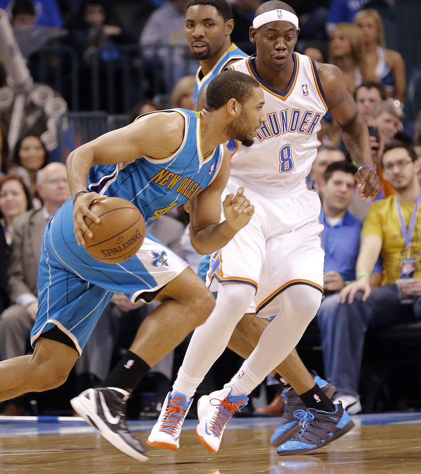 Photo - Oklahoma City Thunder's Ronnie Brewer (8) defends on New Orleans Hornets' Xavier Henry (4) during the NBA basketball game between the Oklahoma City Thunder and the New Orleans Hornets at the Chesapeake Energy Arena on Wednesday, Feb. 27, 2013, in Oklahoma City, Okla. Photo by Chris Landsberger, The Oklahoman