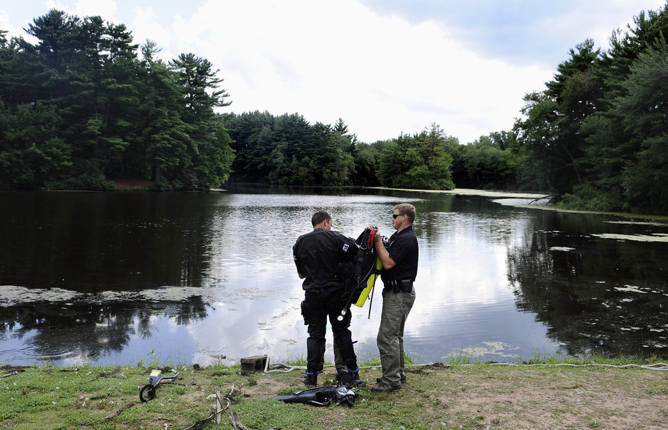Photo - Connecticut State Police Dive Team search Pine Lake in Bristol, Conn., Monday July 29, 2013.  Britol is the hometown of the former New England Patriots player Aaron Hernandez who has pleaded not guilty to murder in the death of Odin Lloyd, a 27-year-old Boston semi-professional football player. (AP Photo/Jessica Hill)