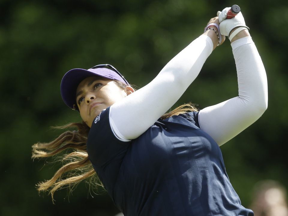 Photo - Lizette Salas watches her tee shot on the fifth hole during the final round of the Kingsmill Championship golf tournament at the Kingsmill resort  in Williamsburg, Va., Sunday, May 18, 2014.  Salas birdied the par-3 hole.  (AP Photo/Steve Helber)