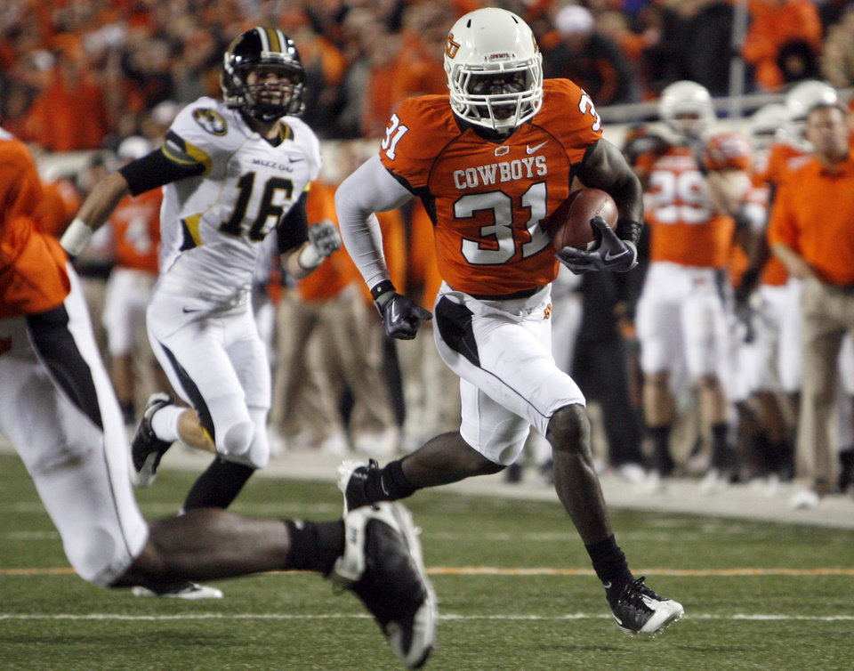 Photo - OSU's Lucien Antoine (31) scores a touchdown off a interception during the college football game between Oklahoma State University (OSU) and the University of Missouri (MU) at Boone Pickens Stadium in Stillwater, Okla. Saturday, Oct. 17, 2009.  Photo by Sarah Phipps, The Oklahoman