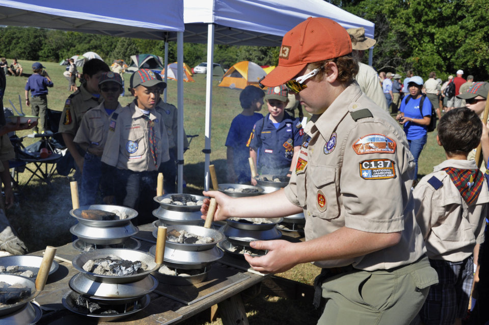 Cameron Horsley, 16, of Bethany, makes campsite pancakes during a Webelos campout on Sept. 21 in Oklahoma City.  Photo by M. Tim Blake, for The Oklahoman