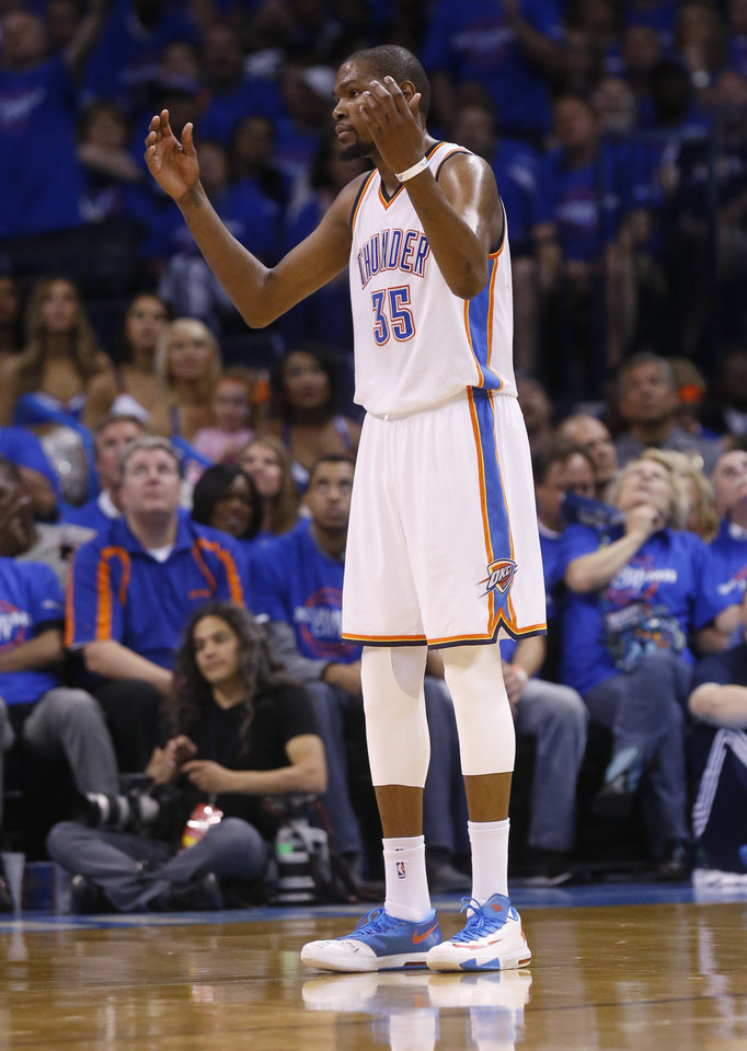Photo - Oklahoma City Thunder forward Kevin Durant gestures during the third quarter of Game 1 of the Western Conference semifinal NBA basketball playoff series against the Los Angeles Clippers in Oklahoma City, Monday, May 5, 2014. Los Angeles won 122-105. (AP Photo/Sue Ogrocki)