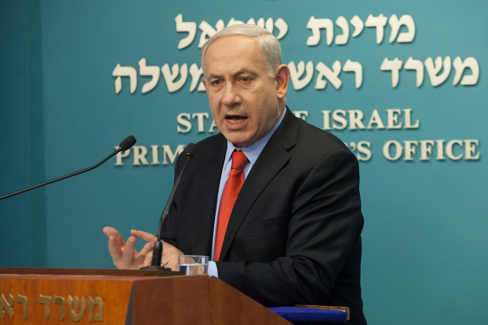 Photo -   Israeli Prime Minister Benjamin Netanyahu gives a statement about an attack that killed five Israeli tourists in Bulgaria, in Jerusalem, Thursday, July 19, 2012. A lanky, long-haired man wearing a baseball cap and plaid shorts with a fake Michigan driver's license carried out a deadly suicide attack on a bus full of Israeli vacationers, Bulgarian officials said Thursday. Israeli Prime Minister Benjamin Netanyahu blamed the attack on Iranian-backed Hezbollah, a Lebanese Shiite Muslim guerrilla group, and threatened retaliation. Seven people — five Israelis, the Bulgarian driver and the bomber — died in the blast Wednesday. (AP Photo/Emil Salman)