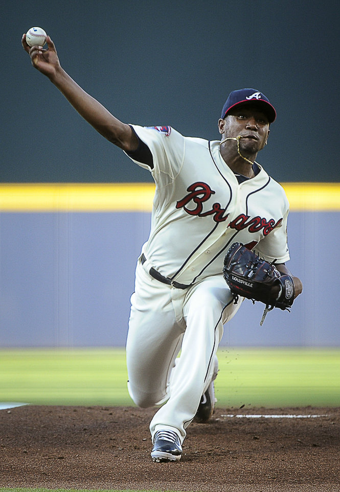 Photo - Atlanta Braves pitcher Julio Teheran works the first inning of a baseball game against the San Diego Padres, Saturday, July 26, 2014, in Atlanta. (AP Photo/John Amis)