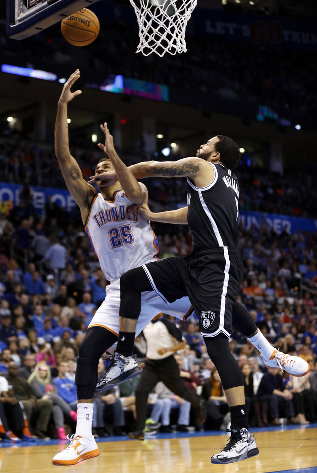 Photo - Thunder's Thabo Sefolosha (25) is fouled on a fast break by Brooklyn's Deron Williams in the first half of an NBA basketball game where the Oklahoma City Thunder were defeated 95-93 by the Brooklyn Nets at the Chesapeake Energy Arena in Oklahoma City, on Thursday, Jan. 2, 2014. Photo by Steve Sisney The Oklahoman