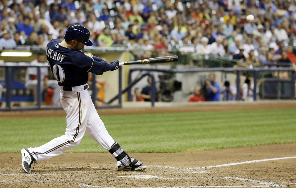Photo - Milwaukee Brewers' Jonathan Lucroy hits a walk off home run during the ninth inning of a baseball game against the Cincinnati Reds, Tuesday, July 22, 2014, in Milwaukee. The Brewers won 4-3. (AP Photo/Morry Gash)