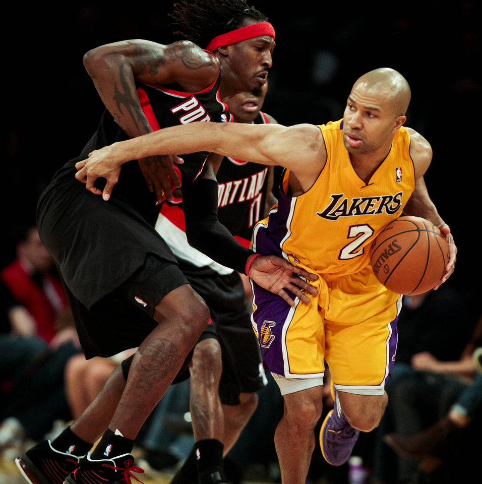 Los Angeles Lakers guard Derek Fisher, right, works his way around Portland Trail Blazers forward Gerald Wallace during the second half on an NBA basketball game, Monday, Feb. 20, 2012, in Los Angeles. The Lakers won 103-92. (AP Photo/Bret Hartman)