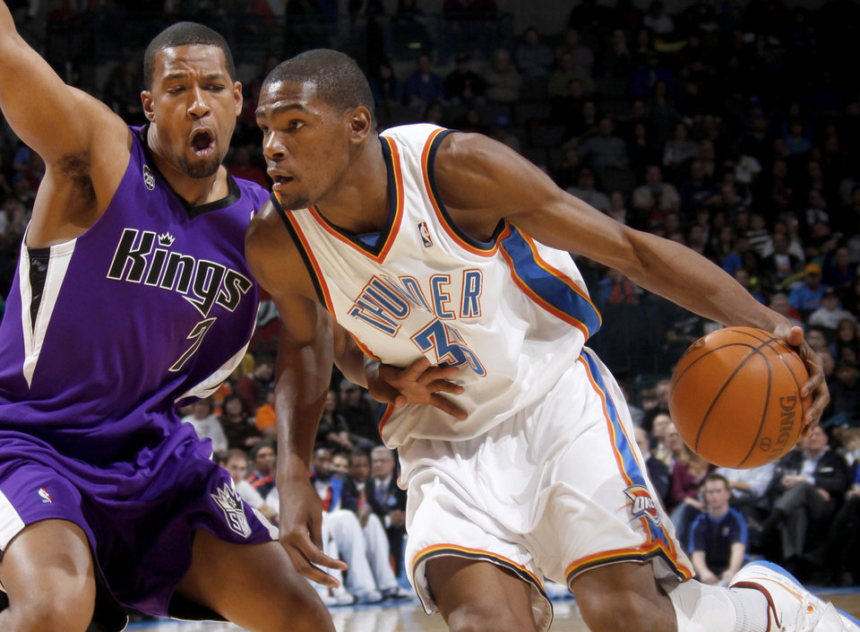 Photo - Oklahoma City's Kevin Durant drives around Sacramento's Dominic McGuire during the NBA basketball game between the Oklahoma City Thunder and the Sacramento Kings at the Ford Center in Oklahoma City, Tuesday, March 2, 2010.  Photo by Bryan Terry, The Oklahoman