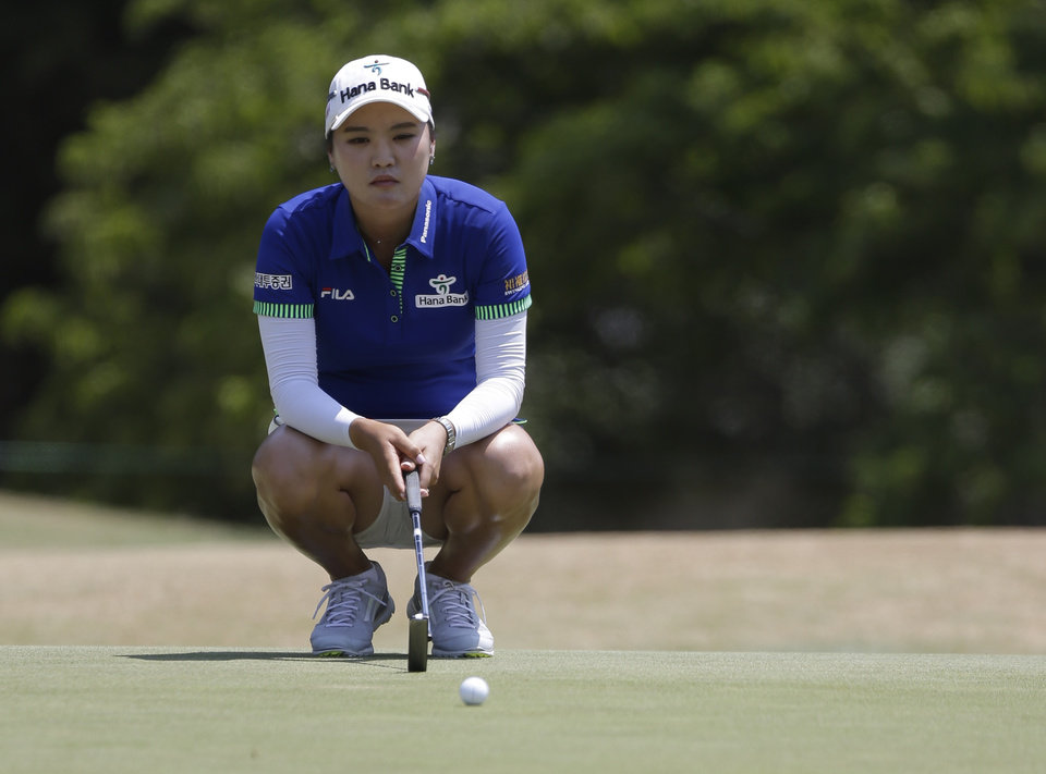 Photo - So Yeon Ryu, of South Korea, lines up a putt on the 13th hole during the first round of the U.S. Women's Open golf tournament in Pinehurst, N.C., Thursday, June 19, 2014. (AP Photo/Bob Leverone)
