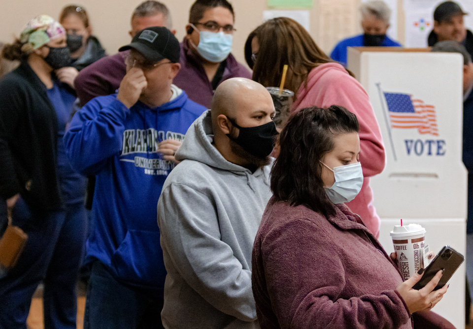 Photo - Voters wait in line to cast their ballots at the International Pentecostal Assembly in Yukon, Okla. on Tuesday, Nov. 3, 2020. [Chris Landsberger/The Oklahoman]