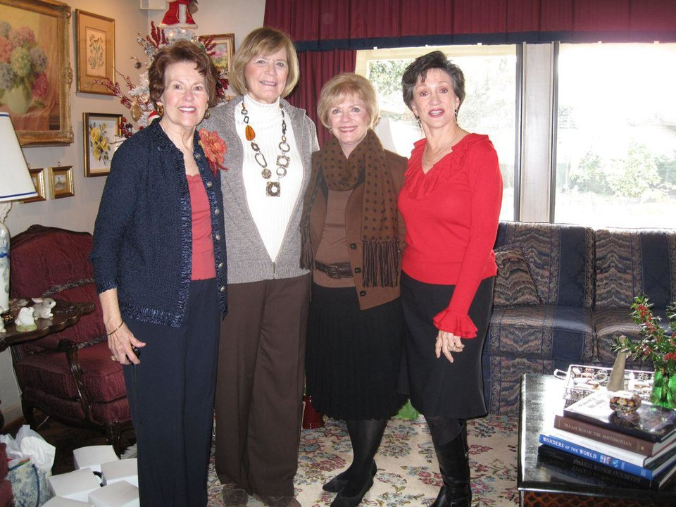 HOLIDAY BRIDGE LUNCHEON....Susie Nelson, Carolyn Hall, Karen Ingram  and Gennie Johnson were at the Lisle home for a gift exchange and  luncheon. The group of 11 women meet monthly for lunch. (Photo by  Helen Ford Wallace).