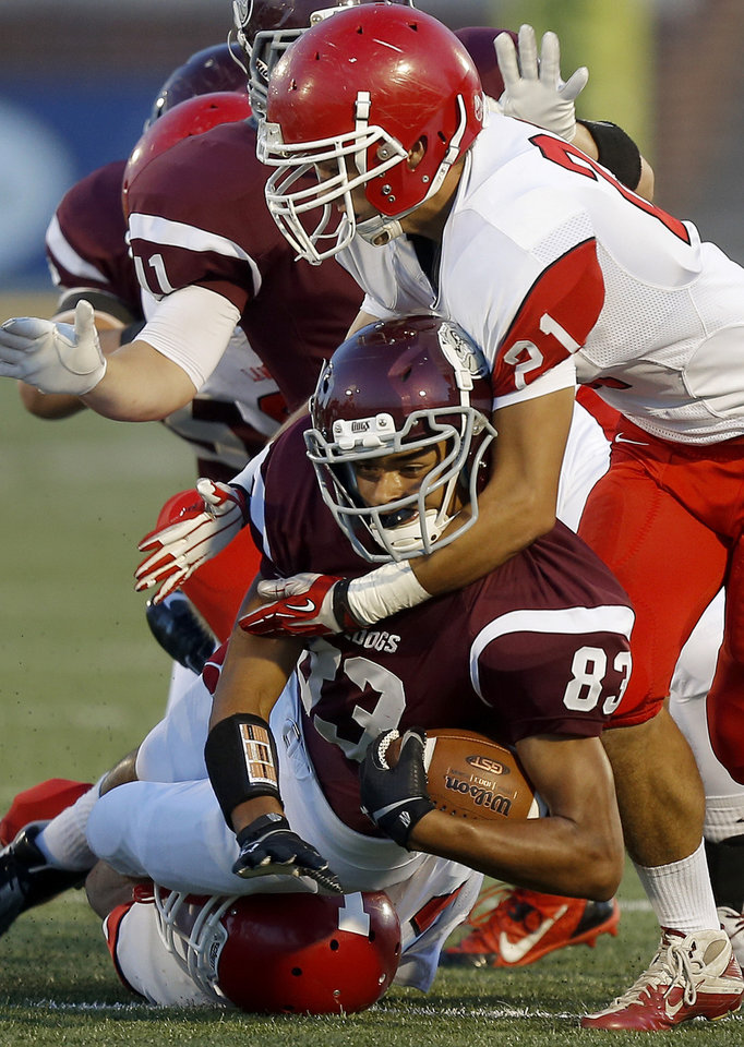 Photo - Edmond Memorial's Donovan Nunley is brought down by Lawton's Mattleon (21) during their high school football game at Wantland Stadium in Edmond, Okla., Friday, Sept. 27, 2013. Photo by Bryan Terry, The Oklahoman