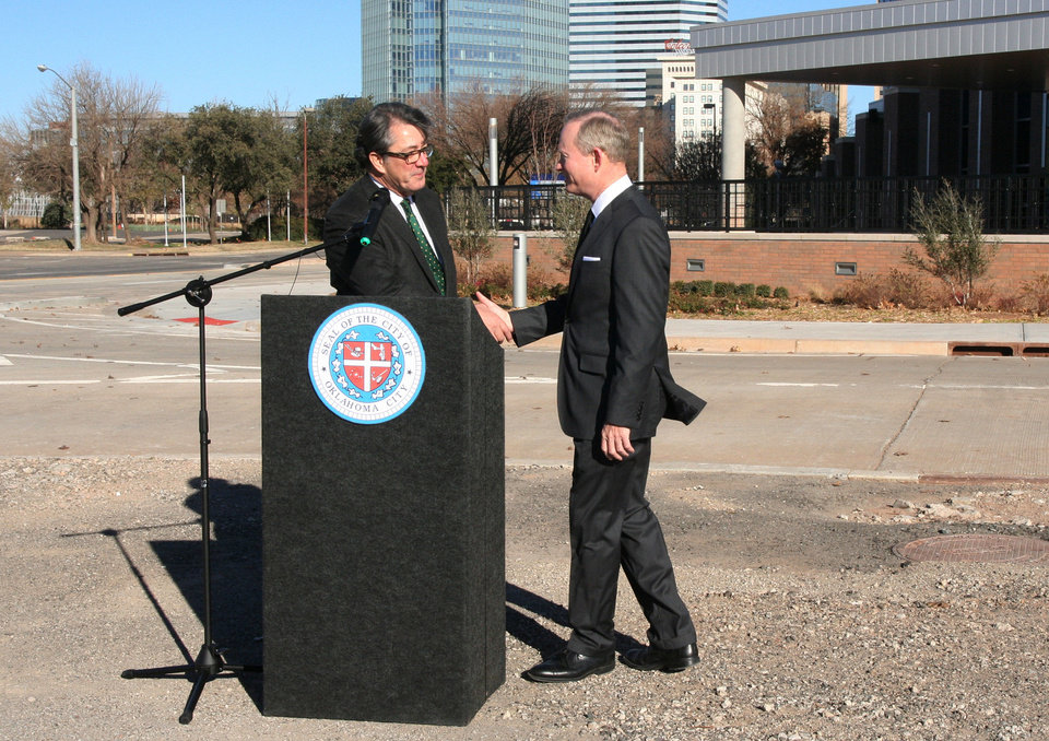 American Architectural Foundation CEO Ron Bogle, left, congratulates Oklahoma City Mayor Mick Cornett, who this spring will receive the foundation's national urban design leadership award.  PHOTO PROVIDED BY THE CITY OF OKLAHOMA CITY