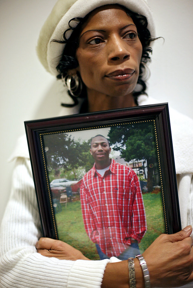 Photo - JoNita Normore holds a picture of her son Ra'Mon Robinson as she talks about his death, 2010. Robinson was shot to death in December 2009. PHOTO BY JOHN CLANTON, THE OKLAHOMAN