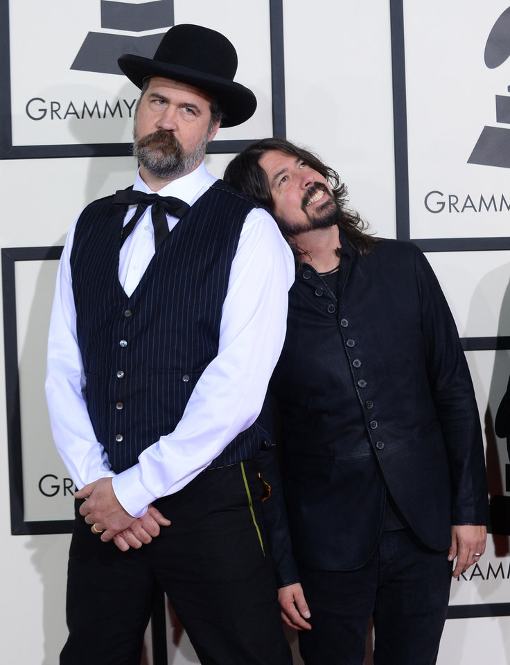 Photo - Krist Novoselic, left, and Dave Grohl arrive at the 56th annual Grammy Awards at Staples Center on Sunday, Jan. 26, 2014, in Los Angeles. (Photo by Jordan Strauss/Invision/AP)
