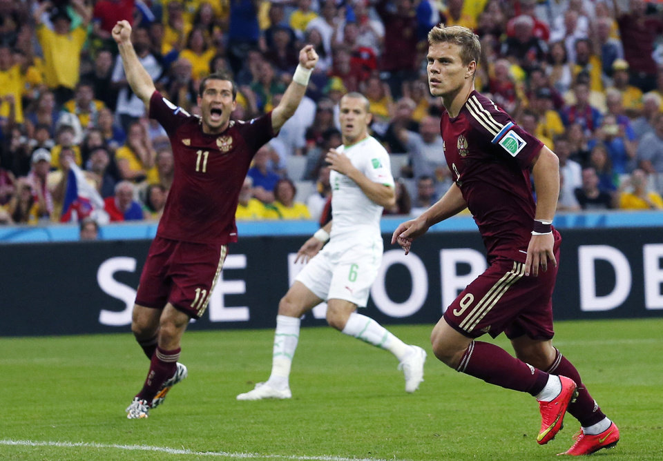 Photo - Russia's Alexander Kerzhakov, left, celebrates after Russia's Alexander Kokorin, right, scored during the group H World Cup soccer match between Algeria and Russia at the Arena da Baixada in Curitiba, Brazil, Thursday, June 26, 2014. (AP Photo/Jon Super)