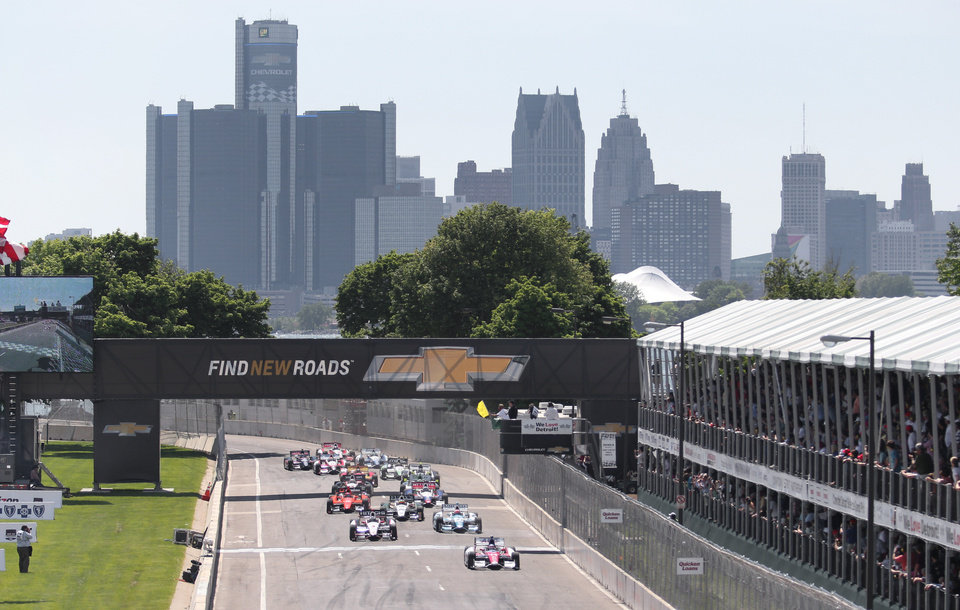 Photo - Takuma Sato (14), of Japan leads the field across the start line under yellow flag during the second race of the IndyCar Detroit Grand Prix auto racing doubleheader in Detroit Sunday, June 1, 2014. (AP Photo/DaveFrechette)
