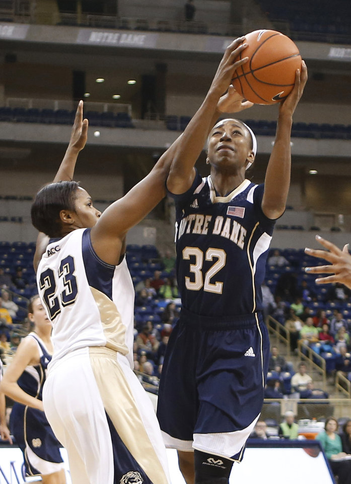 Photo - Notre Dame's Jewell Loyd (32) shoots next to Pittsburgh's Ashlee Anderson (23) during the first half of an NCAA college basketball game Thursday, Jan. 16, 2014, in Pittsburgh. (AP Photo/Keith Srakocic)