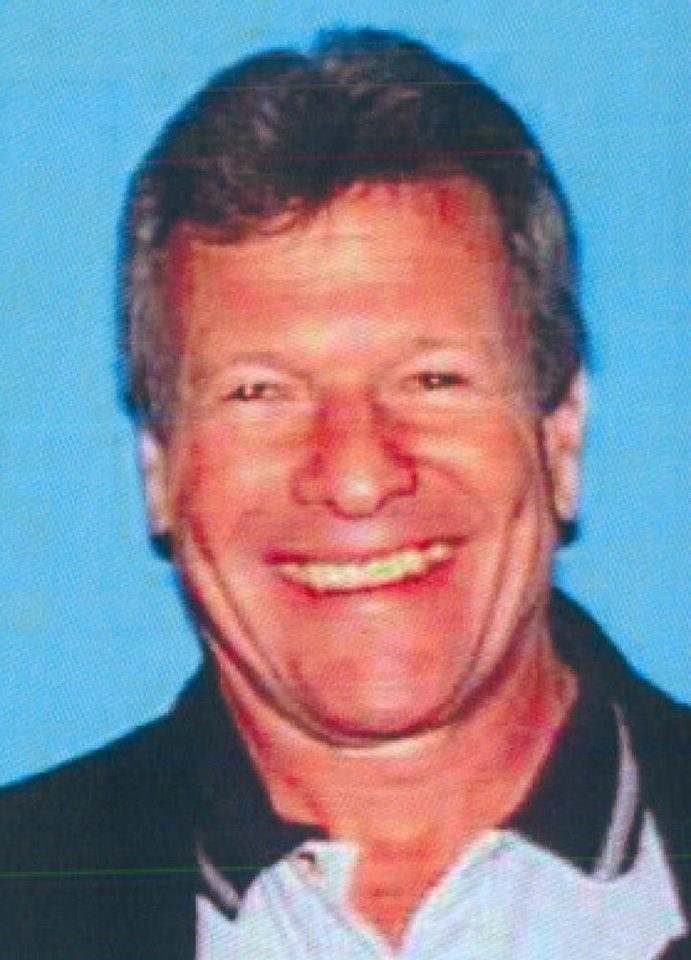 Photo - This photo provided by the California Department of Motor Vehicles shows Melvin Edwards. Edwards, 69, was one of 3 fatalaties during Ali Syed's shooting spree on Tuesday, Feb. 19, 2013. Edwards was forced from his BMW at a stop sign, marched to a curb and shot in the back of the head as other commuters watched in horror. (AP Photo/Dept of Motor Vehicles via The Orange County Register)