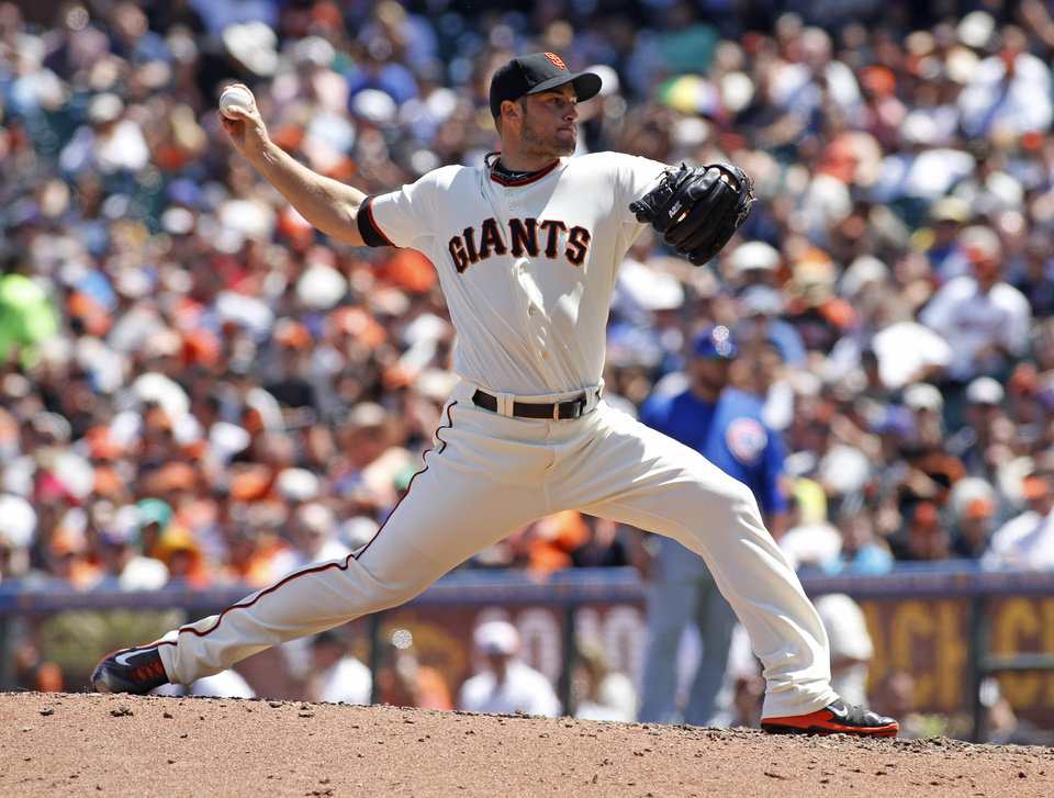 Photo - San Francisco pitcher George Kontos throws to the Chicago Cubs during the sixth inning of a baseball game, Wednesday, May 28, 2014, in San Francisco. (AP Photo/George Nikitin)