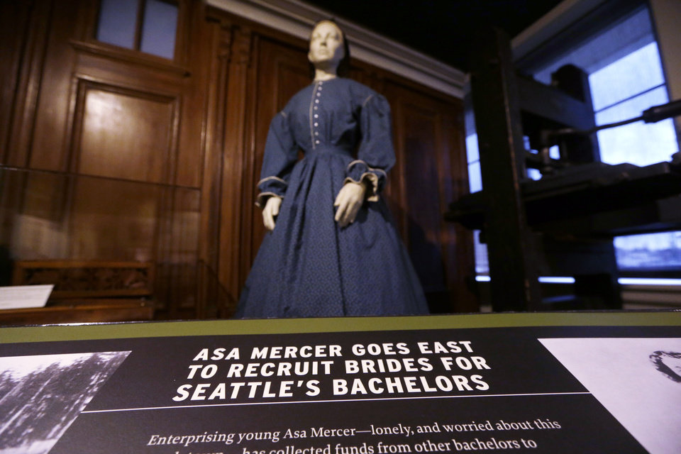 Photo - In this photo taken Wednesday, Dec. 26, 2012, a display features Asa Mercer, who helped recruit brides from back east for Seattle bachelors, at Seattle's Museum of History and Industry, in the city's South Lake Union neighborhood.