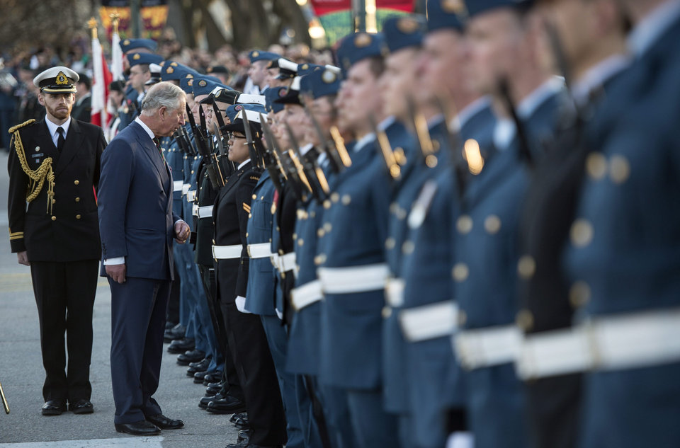 Photo - Prince Charles inspects the honor guard during a farewell ceremony in front of the Manitoba Legislature Wednesday, May 21, 2014 in Winnipeg, Canada. (AP Photo/The Canadian Press,  Paul Chiasson)