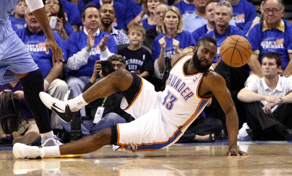 Photo - Oklahoma City's James Harden (13) dives for a loose ball during the first round NBA basketball playoff game between the Oklahoma City Thunder and the Denver Nuggets on Wednesday, April 20, 2011, at the Oklahoma City Arena. Photo by Sarah Phipps, The Oklahoman