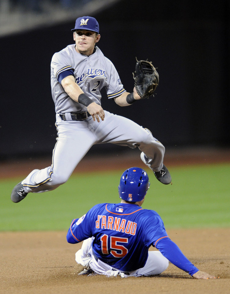 Photo - New York Mets' Travis d'Arnaud (15) is out at second base as Milwaukee Brewers second baseman Scooter Gennett relays the ball to first to complete the double play on Mets' Wilfredo Tovar during the fifth inning of a baseball game Friday, Sept. 27, 2013, in New York. (AP Photo/Bill Kostroun)