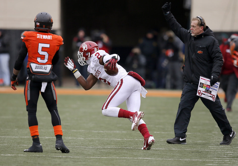 Photo - Oklahoma's Julian Wilson (2) comes up with a pass intended for Oklahoma State's Josh Stewart (5) during the Bedlam college football game between the Oklahoma State University Cowboys (OSU) and the University of Oklahoma Sooners (OU) at Boone Pickens Stadium in Stillwater, Okla., Saturday, Dec. 7, 2013. Oklahoma won 33-24. Photo by Bryan Terry, The Oklahoman
