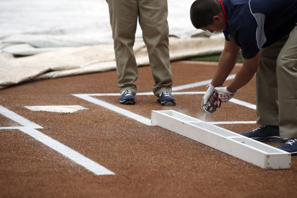 Photo - The grounds crew paints lines around homeplate before an exhibition baseball game between the Washington Nationals and the Detroit Tigers at Nationals Park Saturday, March 29, 2014, in Washington. (AP Photo/Alex Brandon)