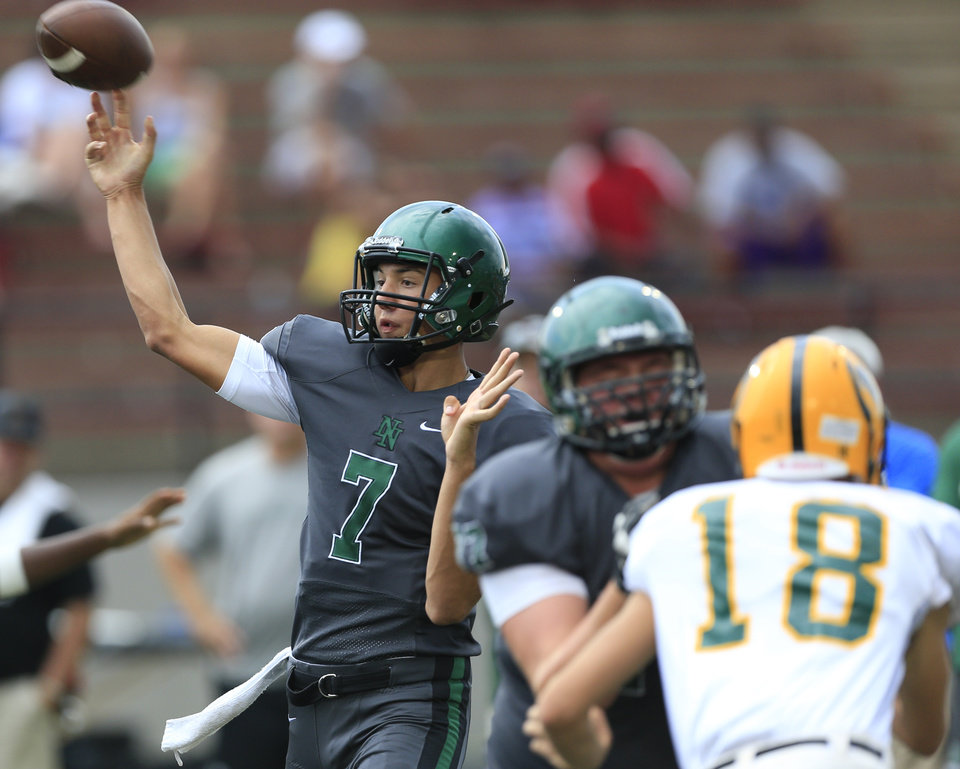 Photo - Norman North's John Kolar throws the ball during a scrimmage at Mustang High School in Mustang, Okla., Thursday, Aug. 28, 2014. Photo by Sarah Phipps, The Oklahoman