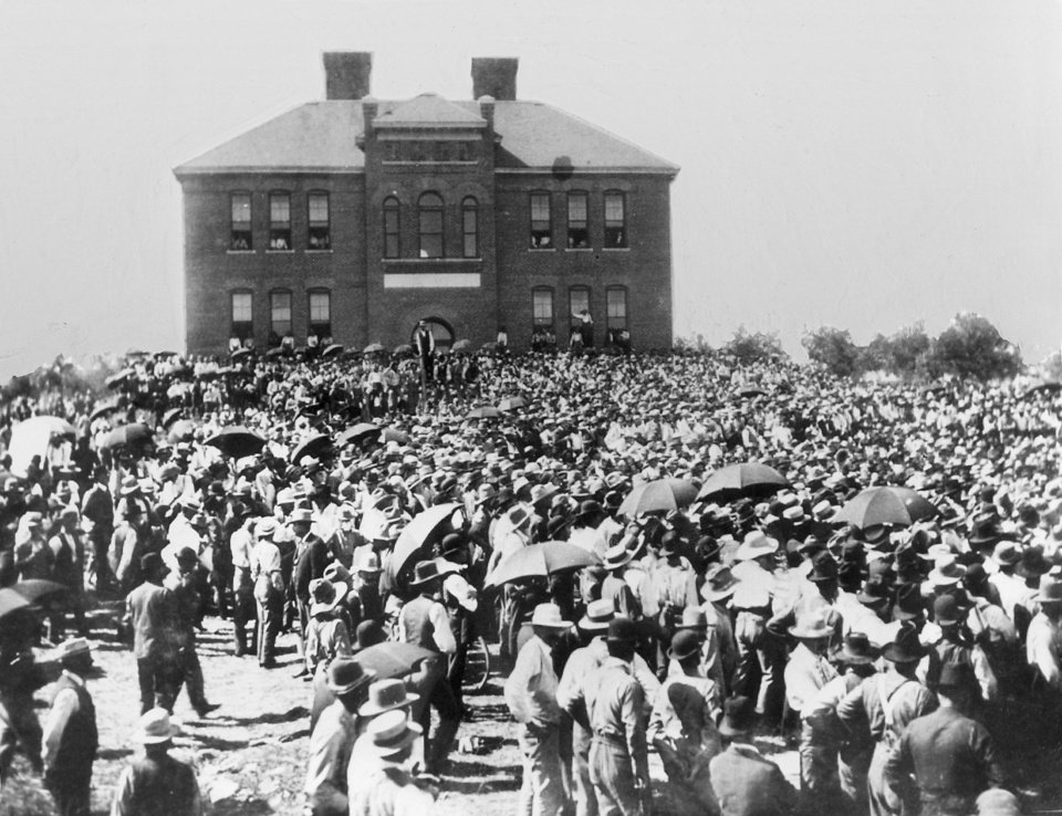 Early Day El Reno.  July 29, 1901.  This photo shows crowd which gathered in front of Irving School, in El Reno, for the drawing of homesteads in Kiowa-Comanche opening.
